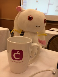 Kyubey posing with my special pink CocoaConf mug