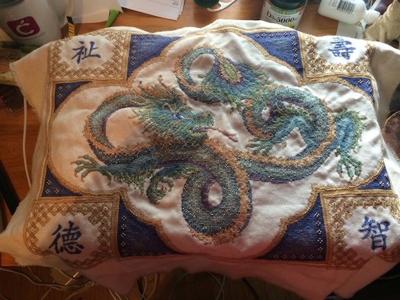 Dragon project requiring over 50 threads, including metallics and beads.