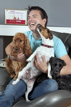 This is John Barrowman covered in puppies. SQUEEE!!!